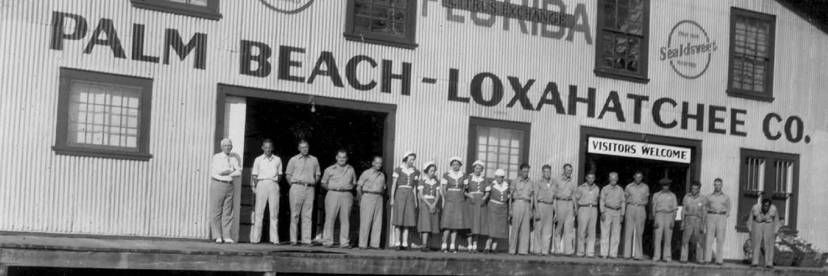 Workers outside a building labeled Palm Beach Loxahatchee Company