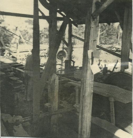 Black and white photo of person working in saw mill